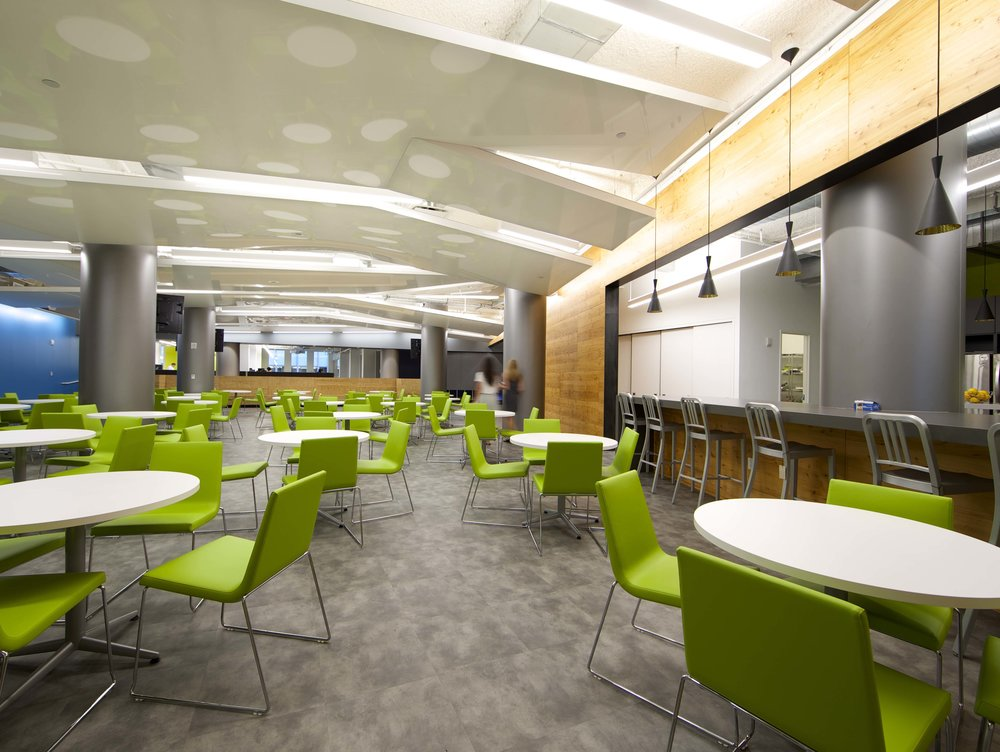 Green chairs in the breakroom area of the Rocketfuel headquarters. MEP by 2L Engineering.