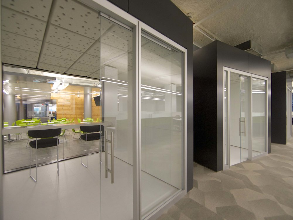 Private glass-enclosed booths in the offices of Rocketfuel. MEP by 2LS Consulting Engineering.