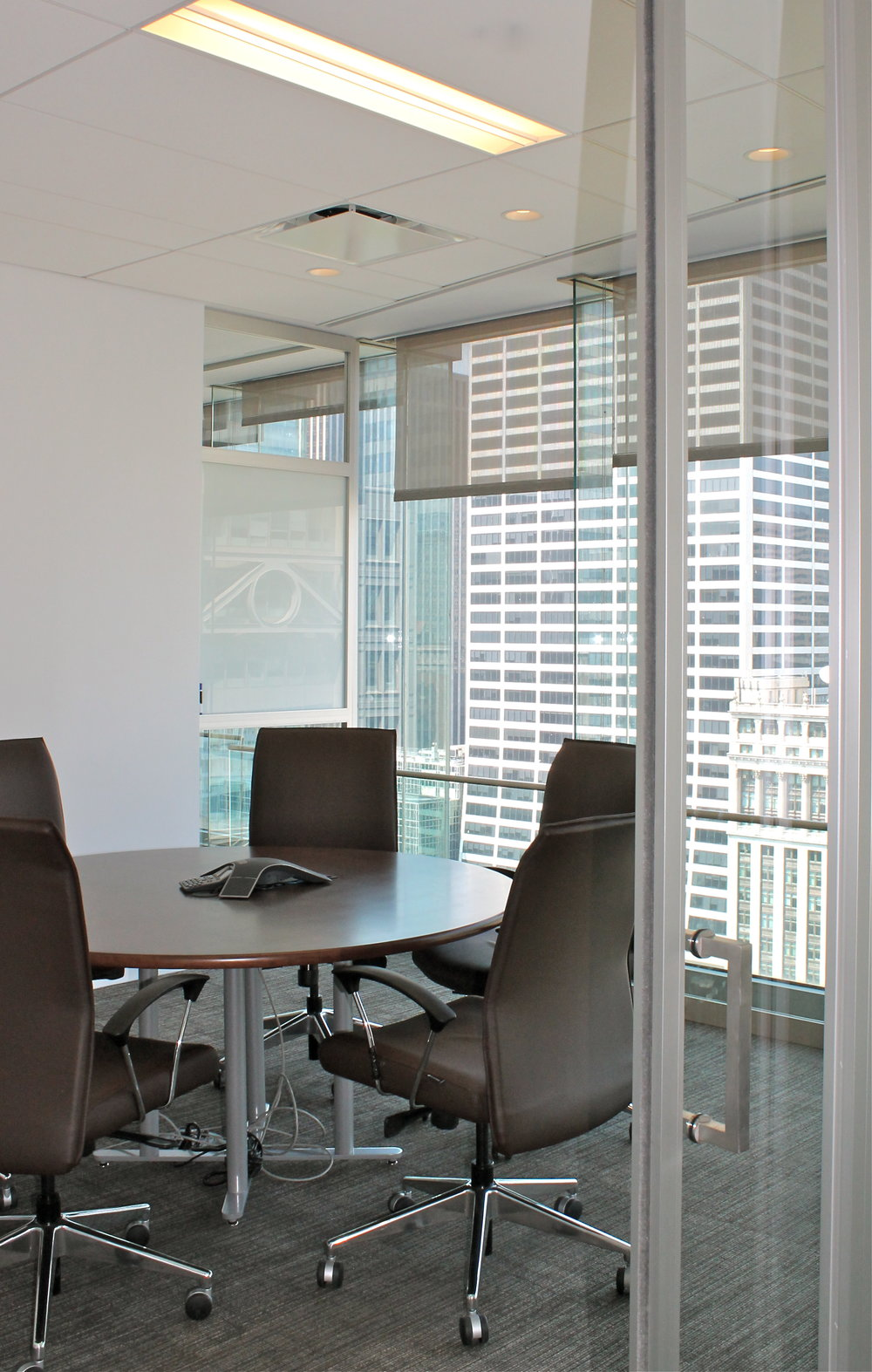 Conference room overlooking the street with floor to ceiling windows in Wood Mackenzie, an energy research and consultancy business. MEP designs by 2LS Consulting Engineering.