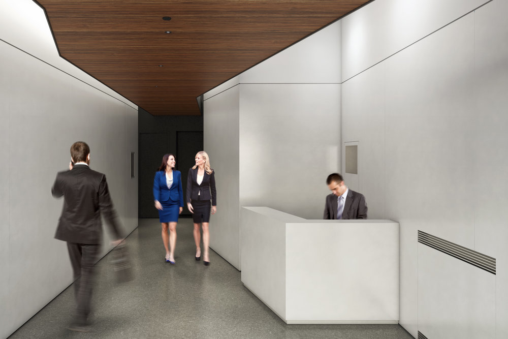Two women talking as they walk down the hallway of Atlas Capital's lobby in New York City. MEP provided by 2LS Consulting Engineering.