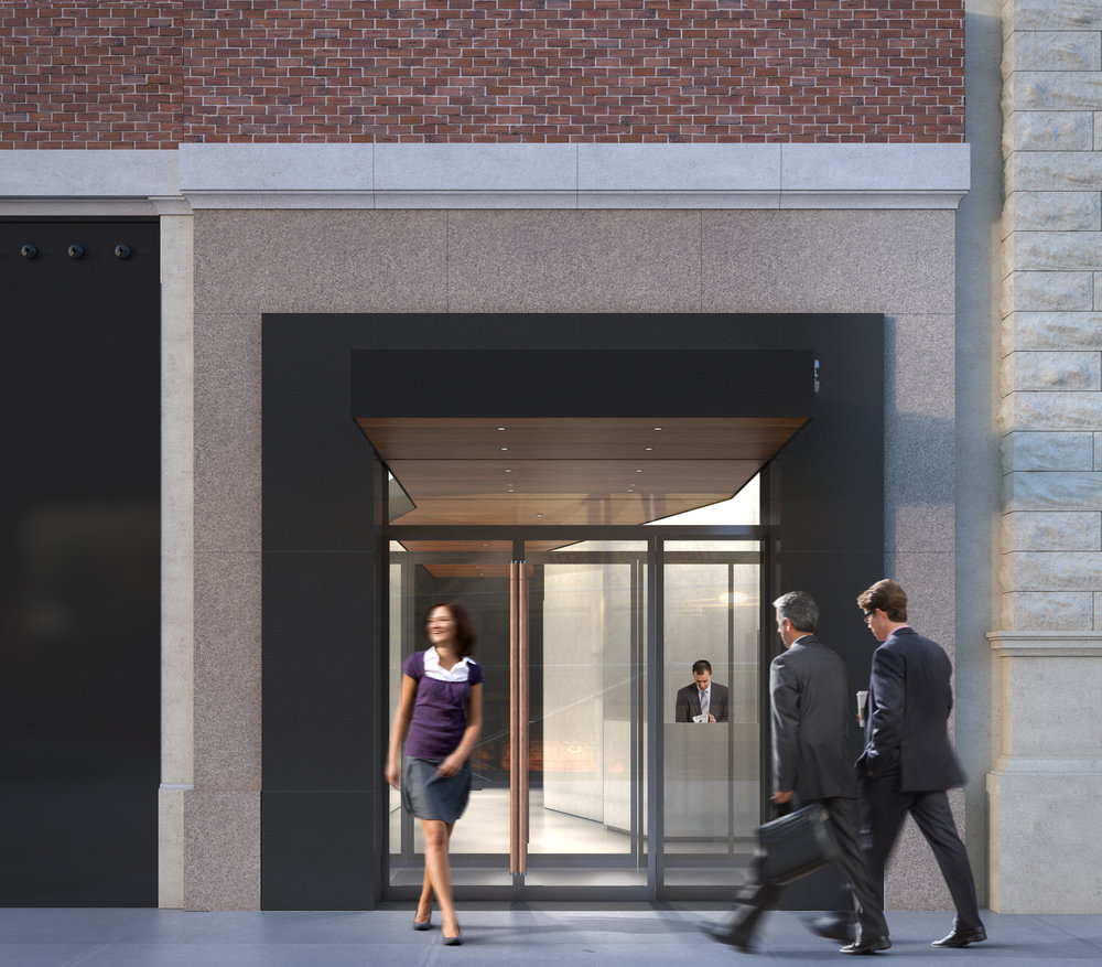 A glimpse from the outside looking into the reception area of Atlas Capital offices building with a woman leaving  and two men walking into the building. MEP provided by 2LS Consulting Engineering.