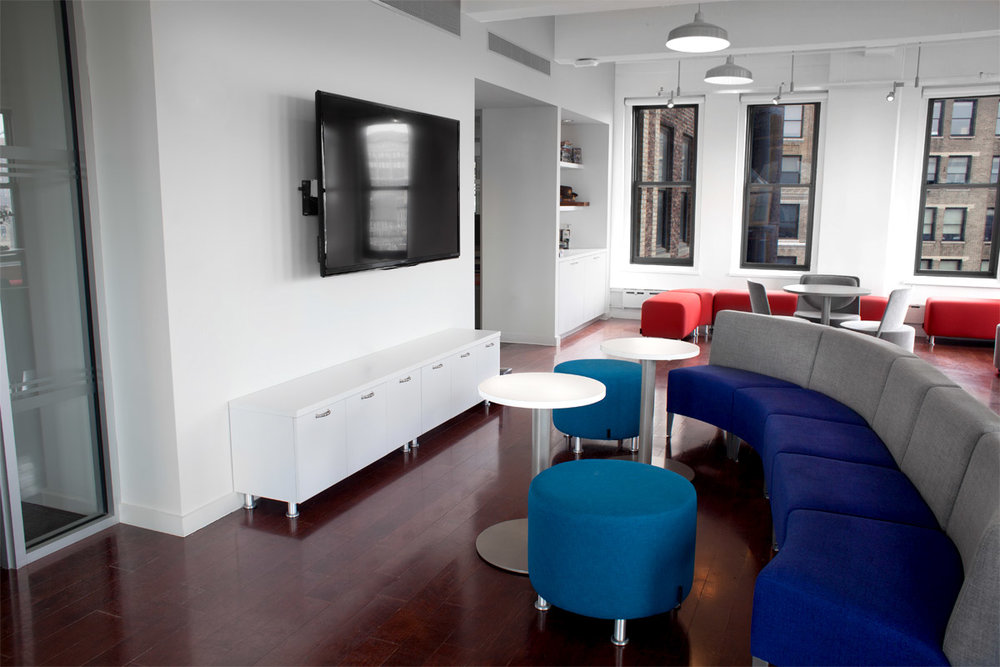 Break room and lounge area with a TV and board games in the office of Publishers Clearing House. MEP provided by 2LS Consulting Engineering.