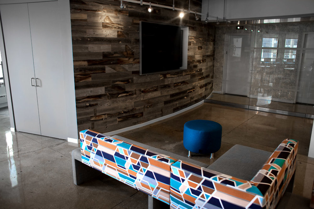 Geometric upholstery on the couch in the waiting area by the reception desk of Publishers Clearing House in New York. MEP designed by 2LS Consulting Engineering.