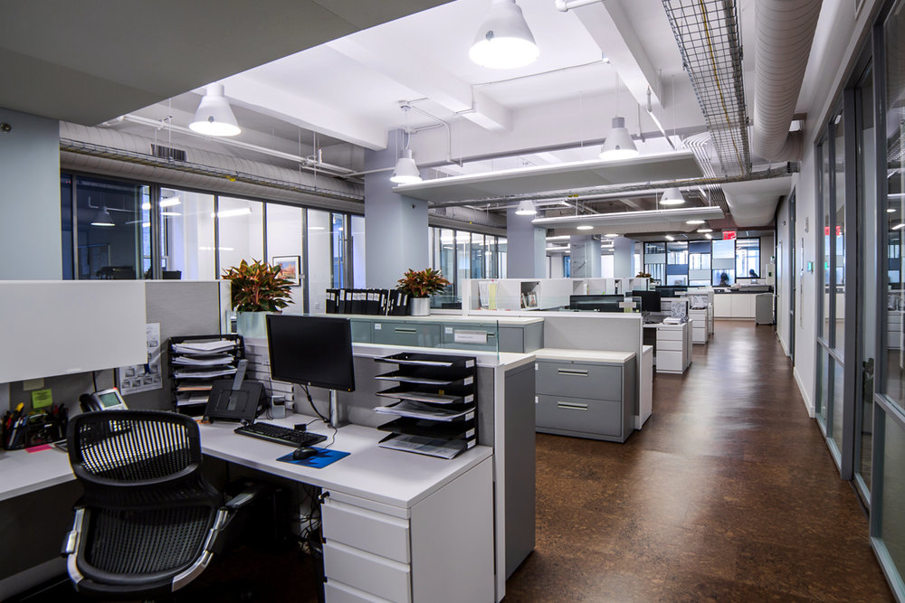 Cubicles and filing cabinets in the office space of Rockrose, a luxury real estate development firm in New York City. MEP designed by 2L Engineering.