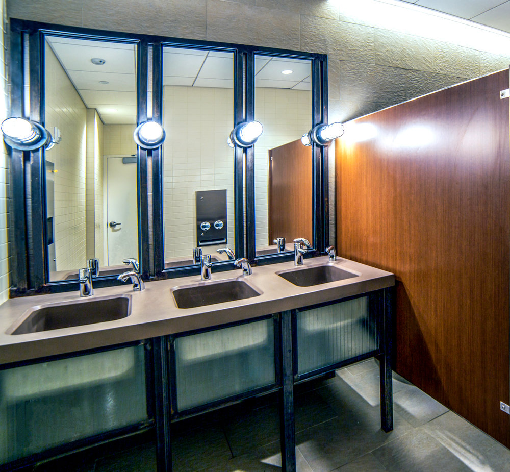 Bathroom with semi-transparent counters in the offices of Rockrose real estate. MEP designed by 2LS Consulting Engineering.