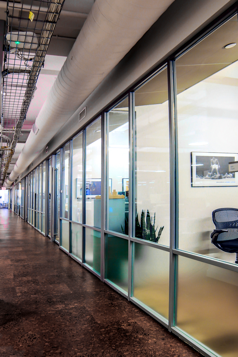 Glass partitions dividing multiple private office spaces in Rockrose real estate development. MEP designed by 2LS Consulting Engineering.