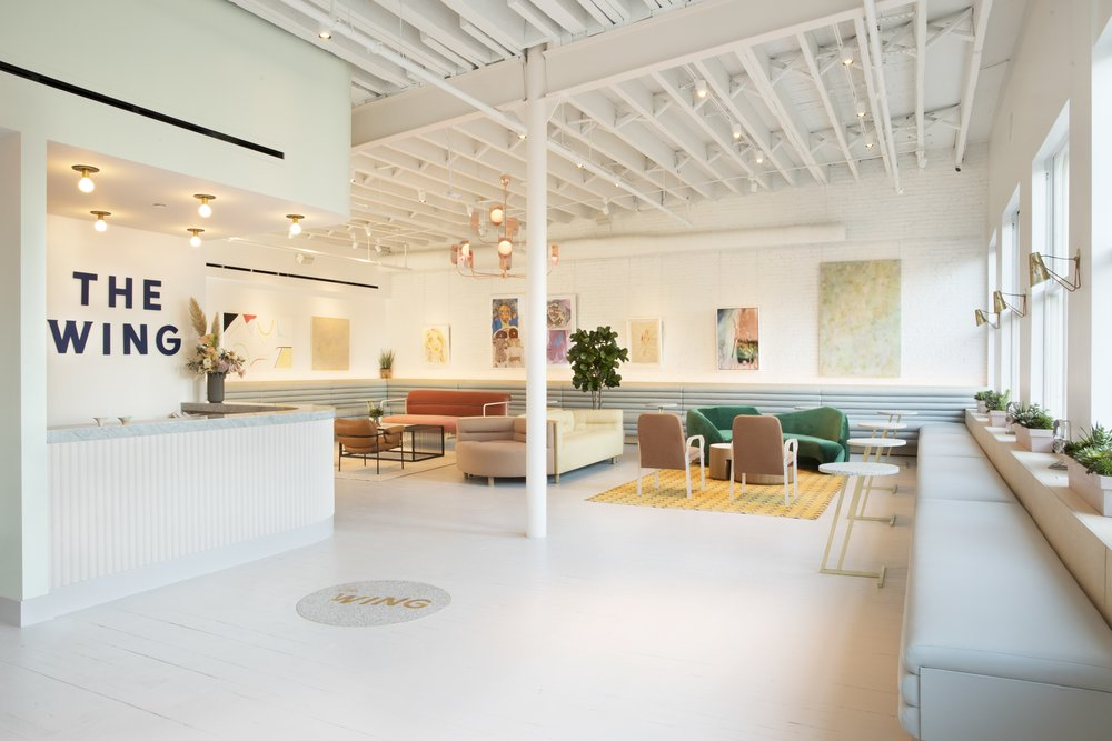 The Wing reception and lounge area designed with pastel, light colors. MEP provided by New York based firm, 2L Engineering.