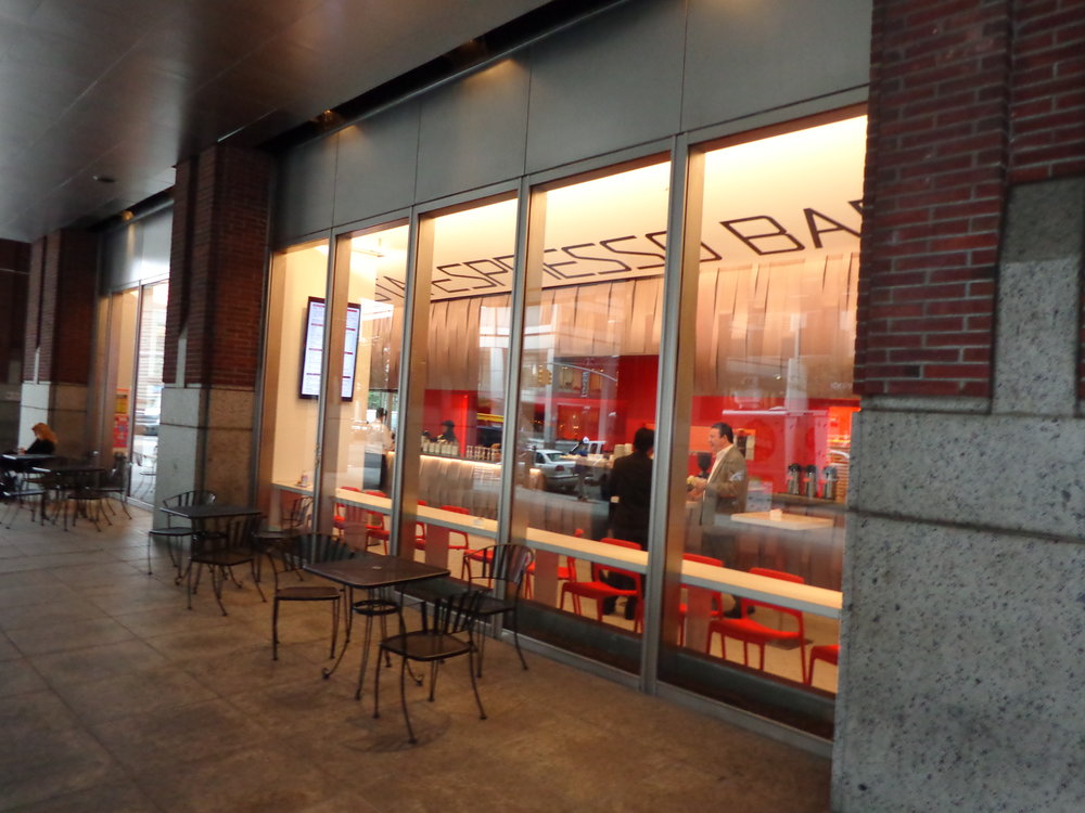 Outside view looking into Robusta Espresso Bar where two customers are having a conversation. MEP provided by 2LS Consulting Engineering.