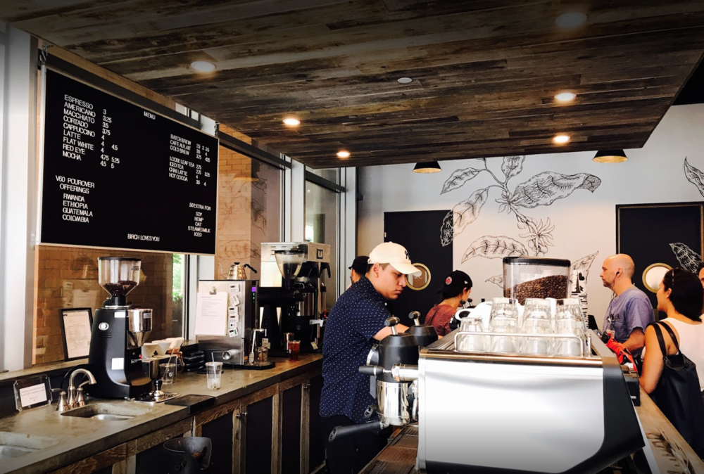 Customers waiting as the baristas prepare their coffee in Birch Coffee, a cafe with MEP design provided by 2L Engineering.