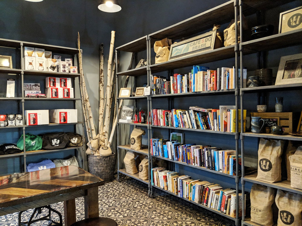 Sharing library and shelving for Birch Coffee products on display at the cafe's East Village location. MEP designs by 2LS Consulting Engineering.