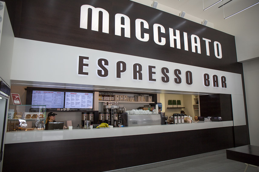 Macchiato Espresso Bar's counter to place orders and prepare coffee and food in thier Fifth Avenue location. MEP provided by 2LS Consulting Engineering.