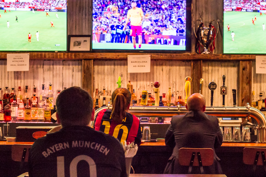 Soccer fans watching the football game on multiple tvs at sports bar, Smithfield Hall, where 2L Engineering provided MEP designs.