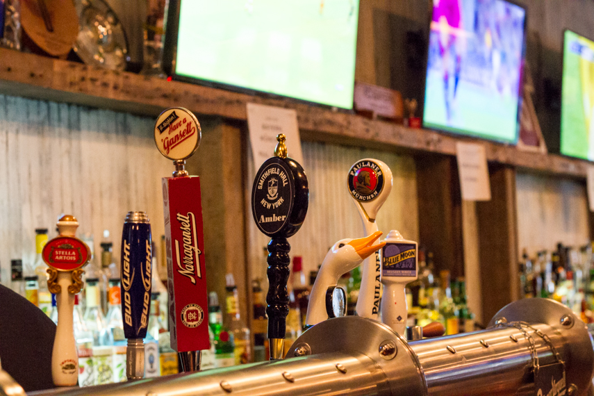 Beer tap options such as Stella Artois, Bud Light, Goose Island, and Blue Moon at Smithfield Hall, a sports bar. MEP provided by 2L Engineering.