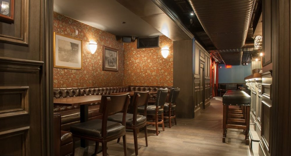 Floral wallpaper and leather seating in the Trading Post. MEP designed by 2L Engineering, a New York based firm.