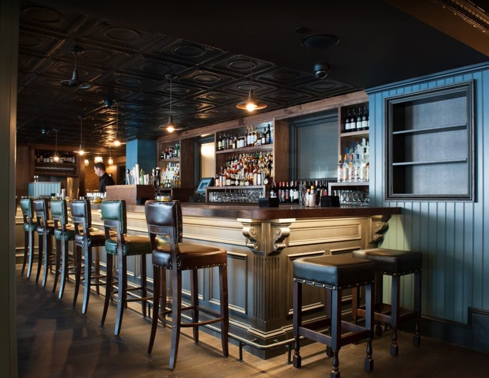 Bartender prepping his station at the Trading Post, a restaurant bar in New York's Financial District where 2L Engineering provided MEP.