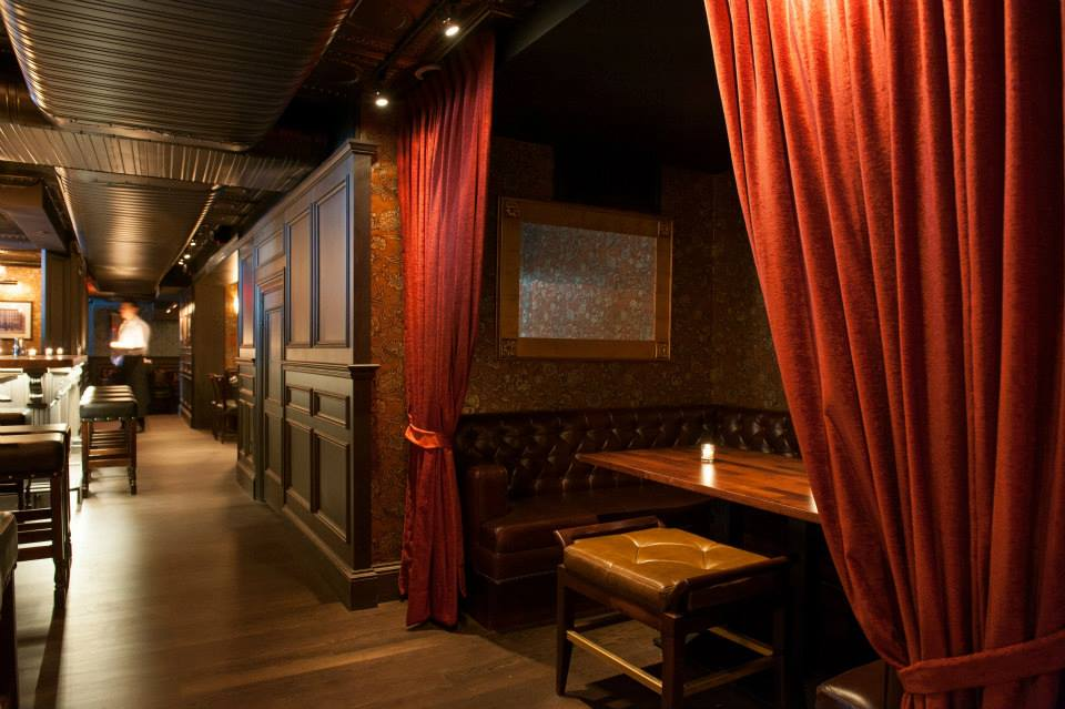 Red curtains to a private booth in the Trading Post, a restaurant and bar with MEP design provided by 2LS Consulting Engineering, a New York based firm.
