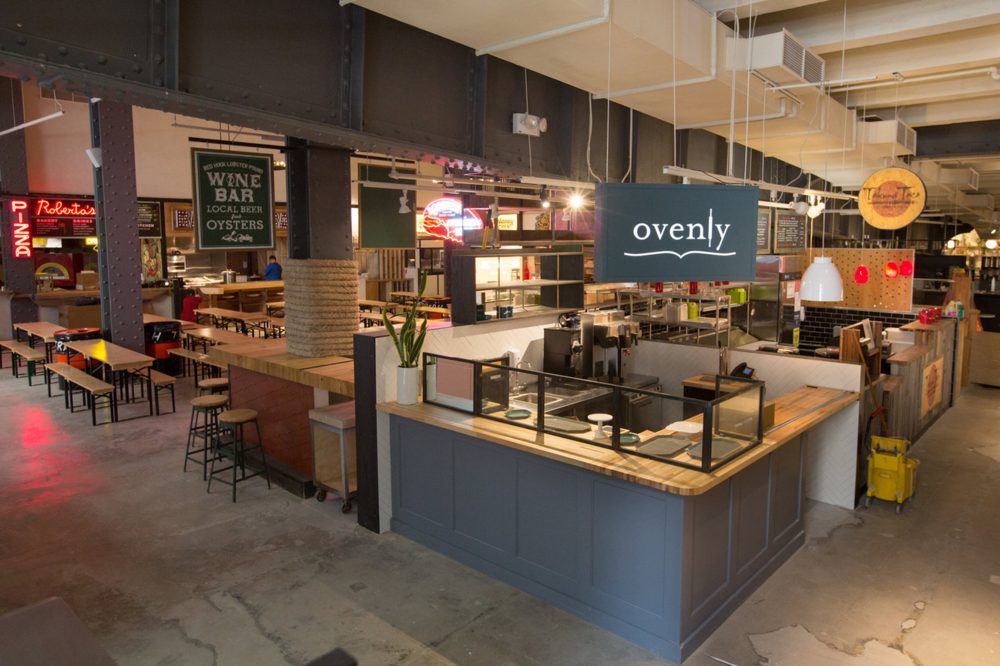 Ovenly's food stall with rustic design in Urbanspace Vanderbilt, a large food hall featuring over twenty counter-served eateries. MEP designed by 2L Engineering, a New York firm.