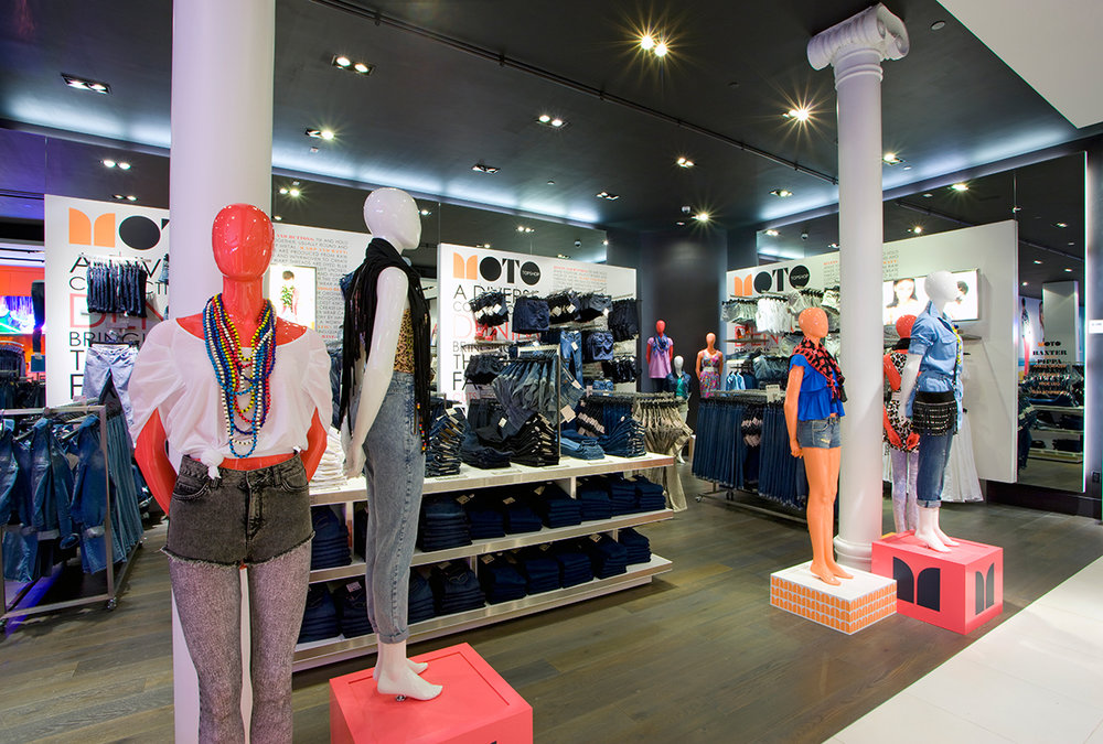 Mannequins with their hands behind their backs displaying the latest in women's fashion and wearing beaded necklaces in the New York location of British retailer, Topshop. MEP by 2L Engineering