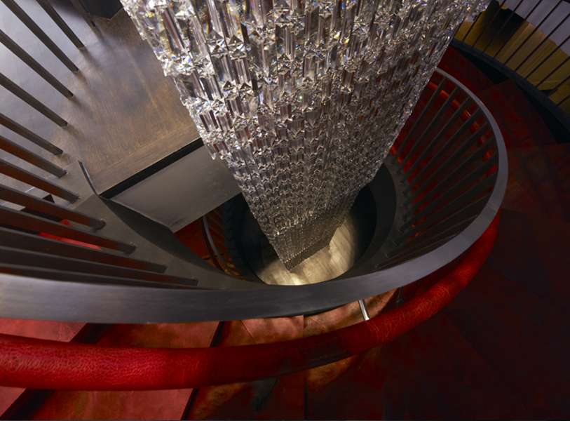 View from the top of the staircase looking down along the orante chandelier column at Institute Erno Laszlo Skincare, a luxury skincare retail store and spa. MEP by New York firm 2LS Consulting.