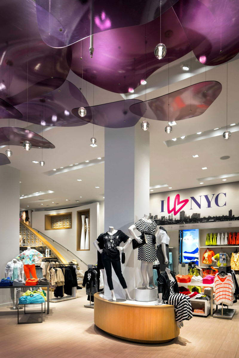 Mannequins standing on display tables surrounded by colorful clothing at the flagship retail store of Lane Bryant in Midtown Manhattan. MEP provided by 2L Engineering.