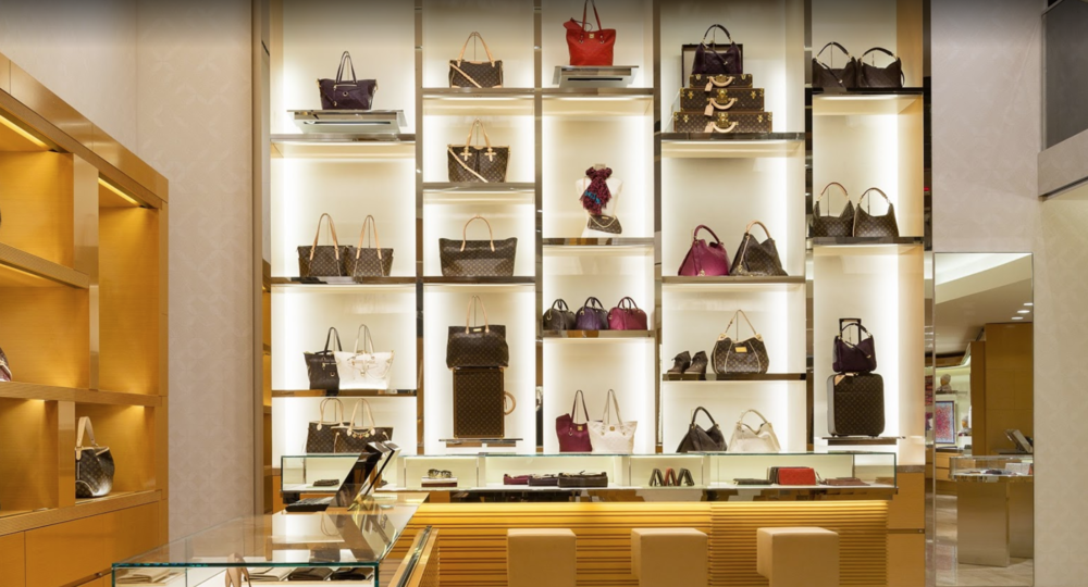 Bags, luggage, shoes, and other Louis Vuitton products on display at the luxury brand's flagship store located in Macy's Herald Square, New York. MEP designed by 2LS Consulting.