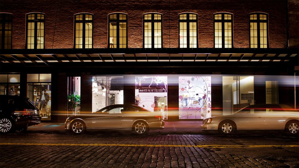 Exterior view of Sephora Sensorium, a fragrance space pop up by Chelsea Market in New York, facing the cobblestone road and cars parked. MEP designed by 2LS Consulting.