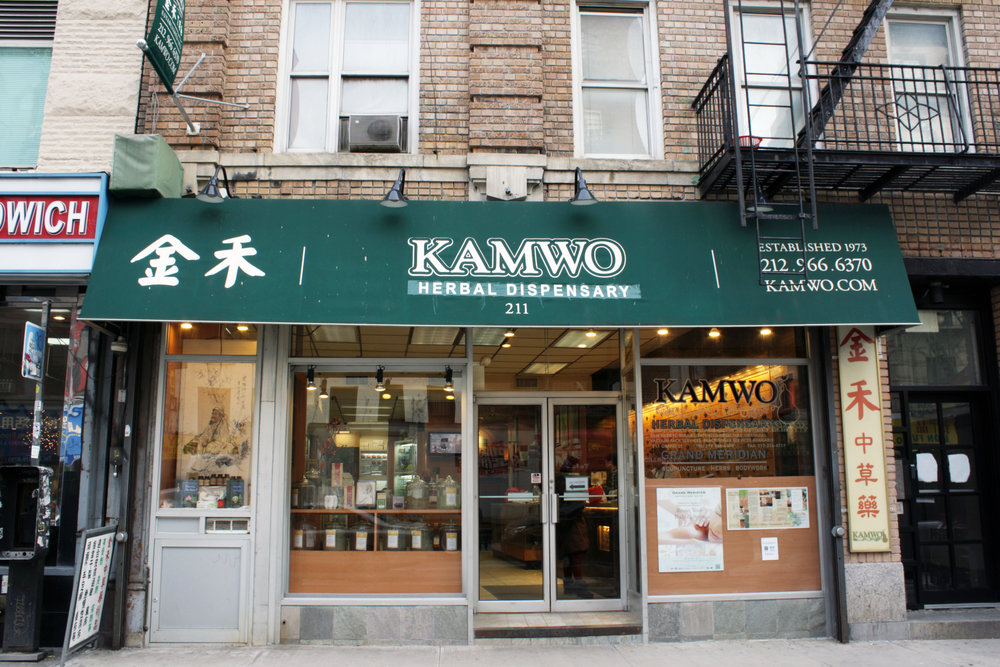 Exterior window display of Kamwo Meridian Herbal Pharmacy's renovated space. MEP designed by 2LS Consulting Engineering.