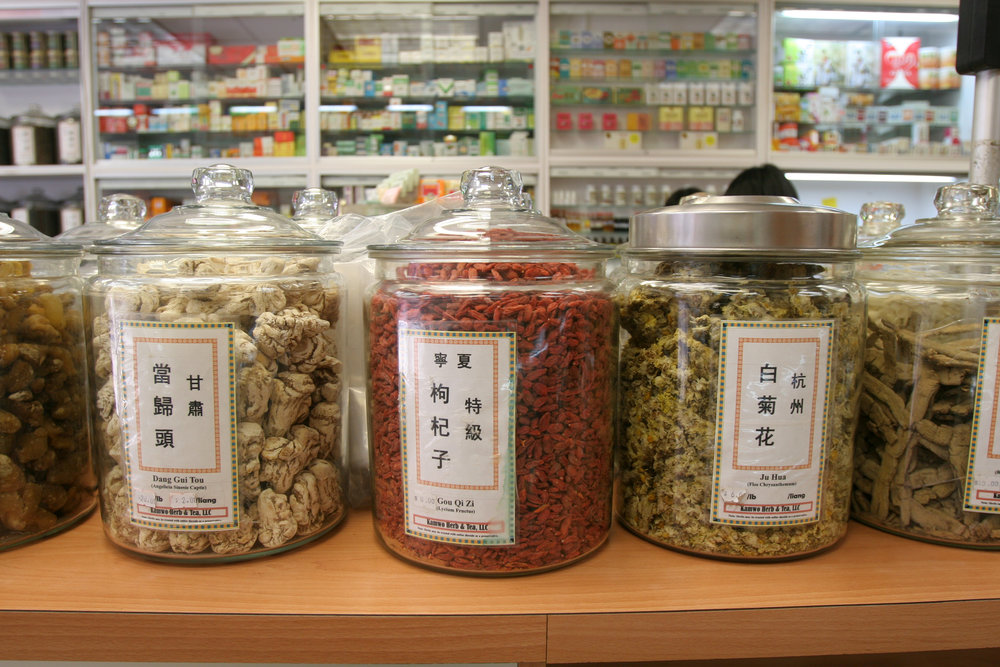 Different medicinal herbs on display in jars at Kamwo Meridian Herbal Pharmacy in Chinatown, New York. MEP provided by 2LS Consulting Engineering.