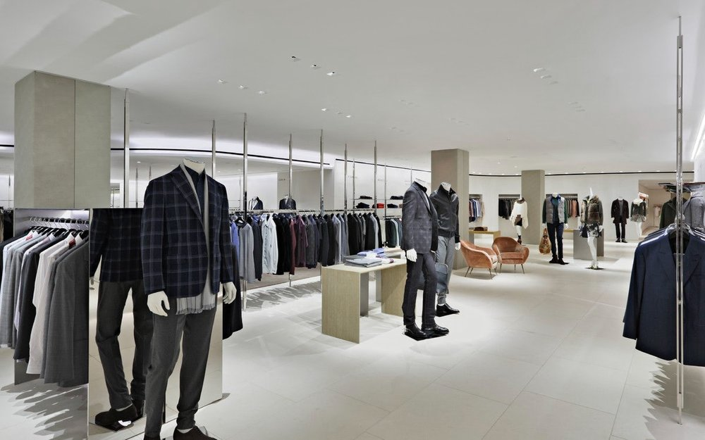 Menswear featuring fall and winter looks on mannequins and display racks in Barney's New York. MEP designed by 2L Engineering.