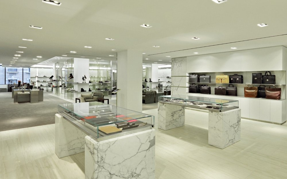 Shoes, bags, and wallets on display in Barney's New York for customers to view. MEP designed by 2L Engineering.