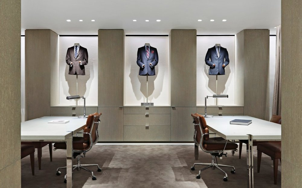 Suited up mannequins by private meeting tables in Barney's New York department store. MEP provided by 2LS Consulting Engineering.