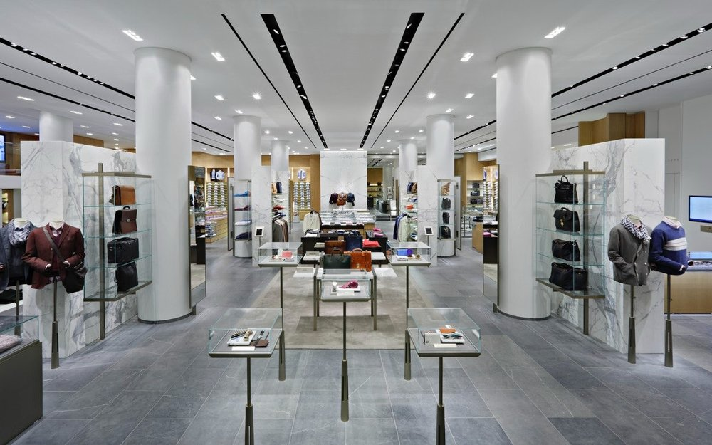 Overview of the mens section featuring different accessories in a minimalistic interior at Barney's New York. MEP designed by 2LS Consulting Engineering.