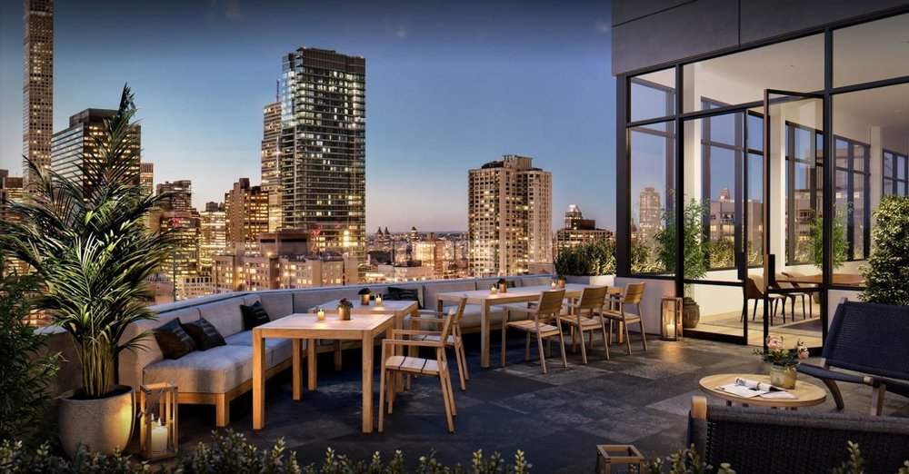 Outdoor seating space overlooking the New York skyline on the balcony of a luxury apartment building. MEP designed by 2L Engineering.
