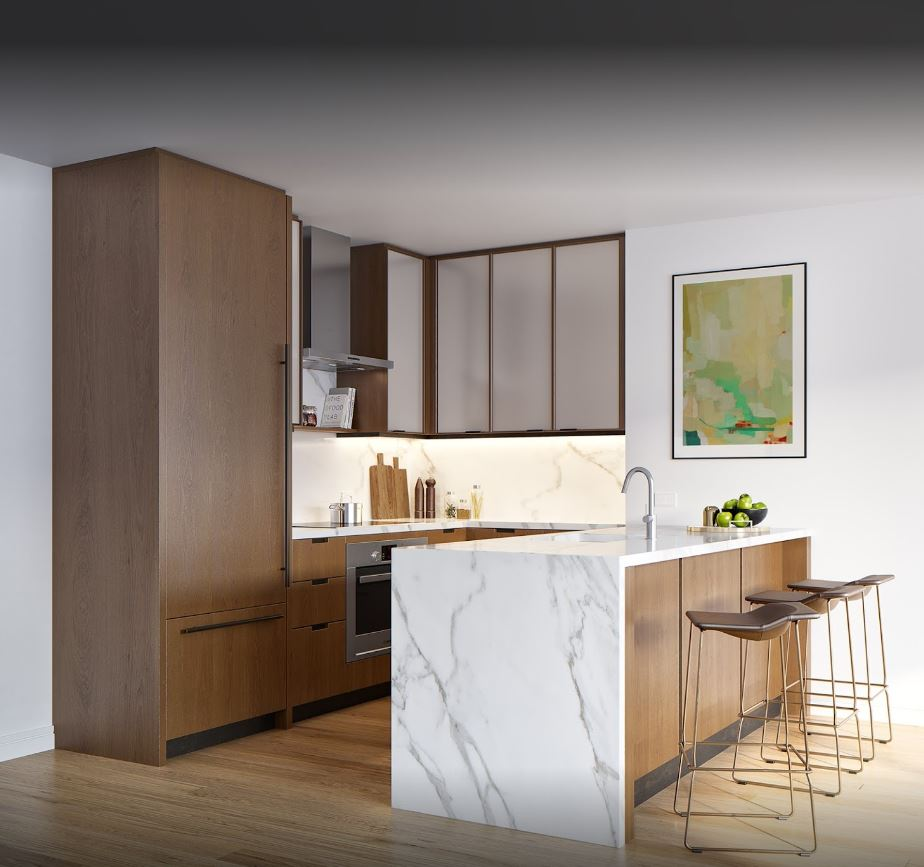 Kitchenette with an island counter, apples, and abstract art on the wall. MEP designed by 2L Engineering.