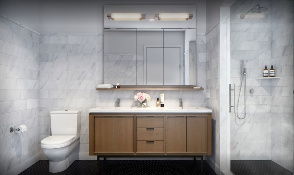 Modern bathroom with marble tiles and wood storage with MEP designed by 2LS Consulting Engineering, a New York based firm.