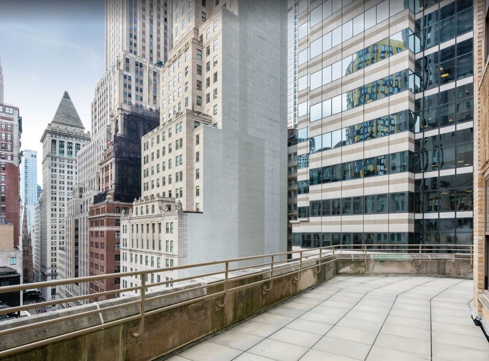 Balcony of a luxury residential building looking over New York. MEP designed by 2L Engineering.