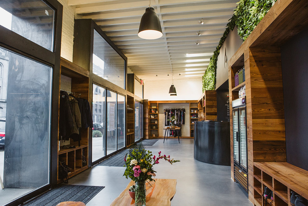 Reception and retail area with storage spaces for guests in the Modo Yoga located in Brooklyn, New York. MEP designed by 2L Engineering.
