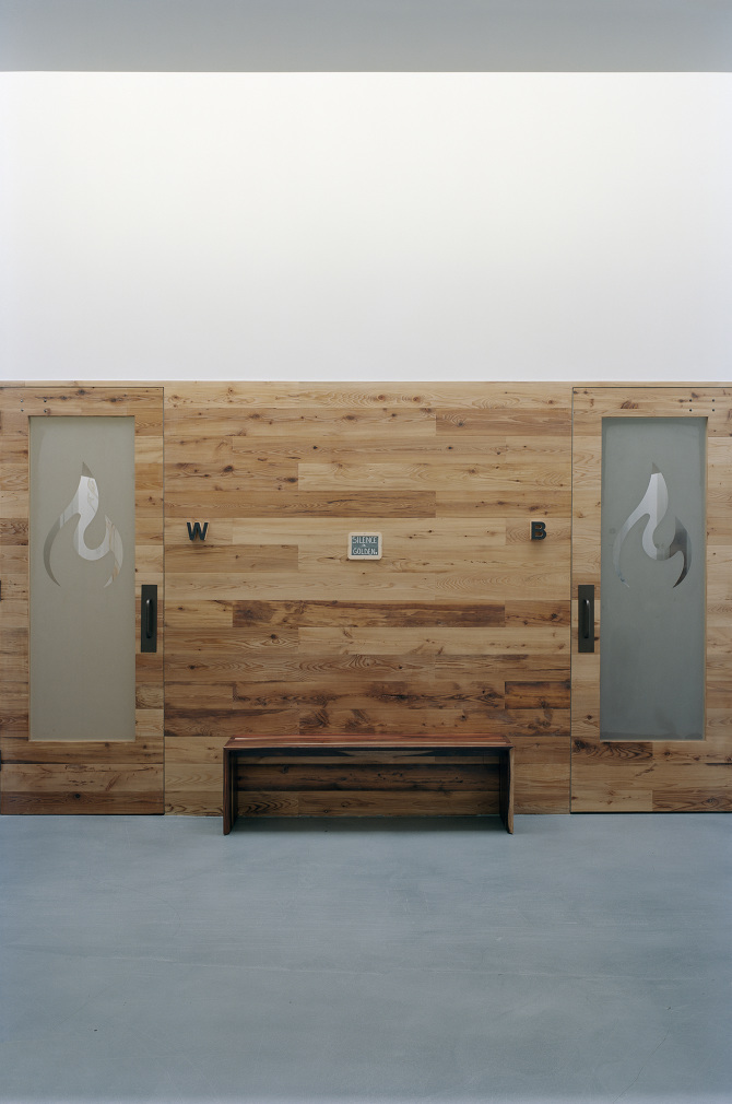 Wooden doors with frosted glass windows and the Modo Yoga logo and a sign between reading, 'Silence is Golden.' MEP designed by 2L Engineering.