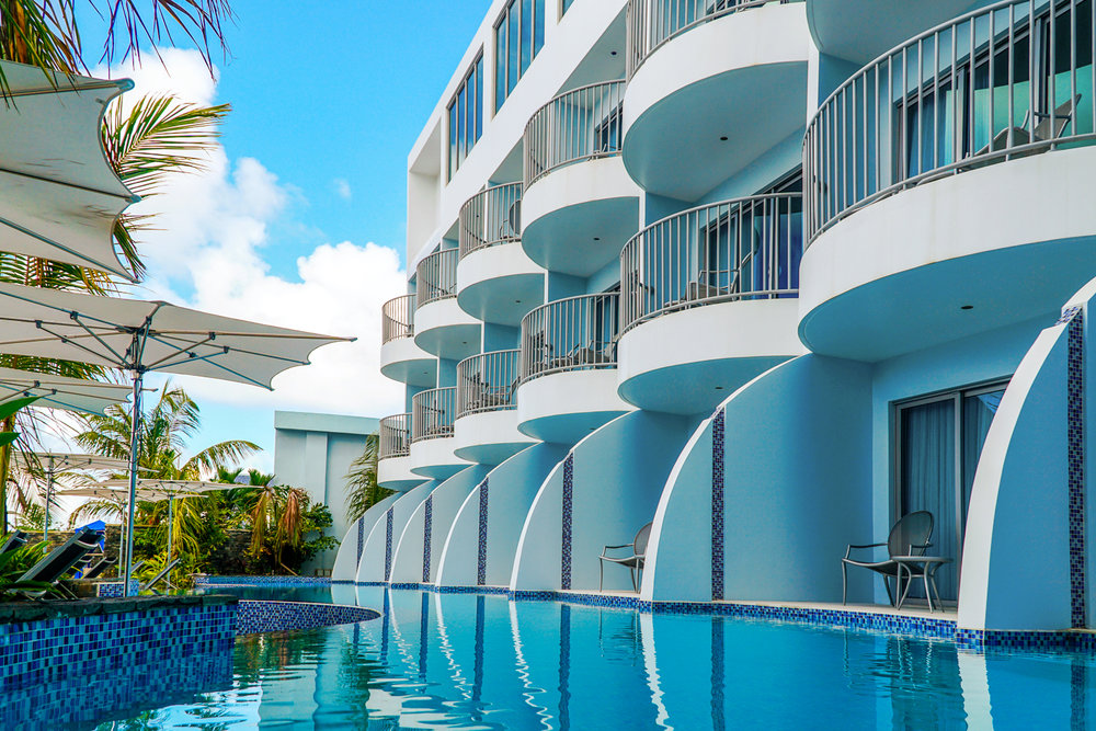 Poolside balconies and hotel rooms on a clear, sunny day in St. Lucia's Harbor Club Hotel. MEP designed by 2L Engineering..