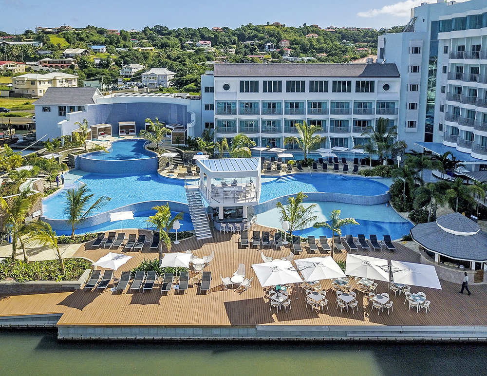 Wideshot of the pools, lounge, and bar and eating area at the Harbor Club Hotel in St. Lucia. MEP designed by 2L Engineering.