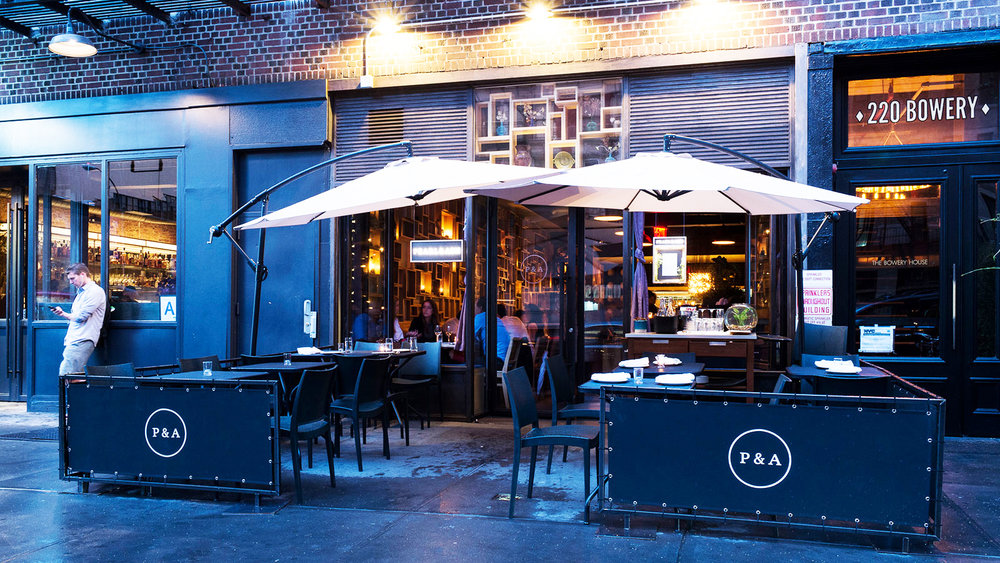 Outdoor seating at restaurant and wine bar, Pearl and Ash, on Bowery Street in New York. MEP designed by 2L Engineering.