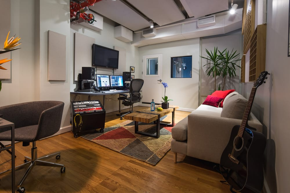 A private studio space in the offices of Napoleon in Brooklyn with midcentury modern design and special recording equipment. MEP designed by 2LS Consulting.
