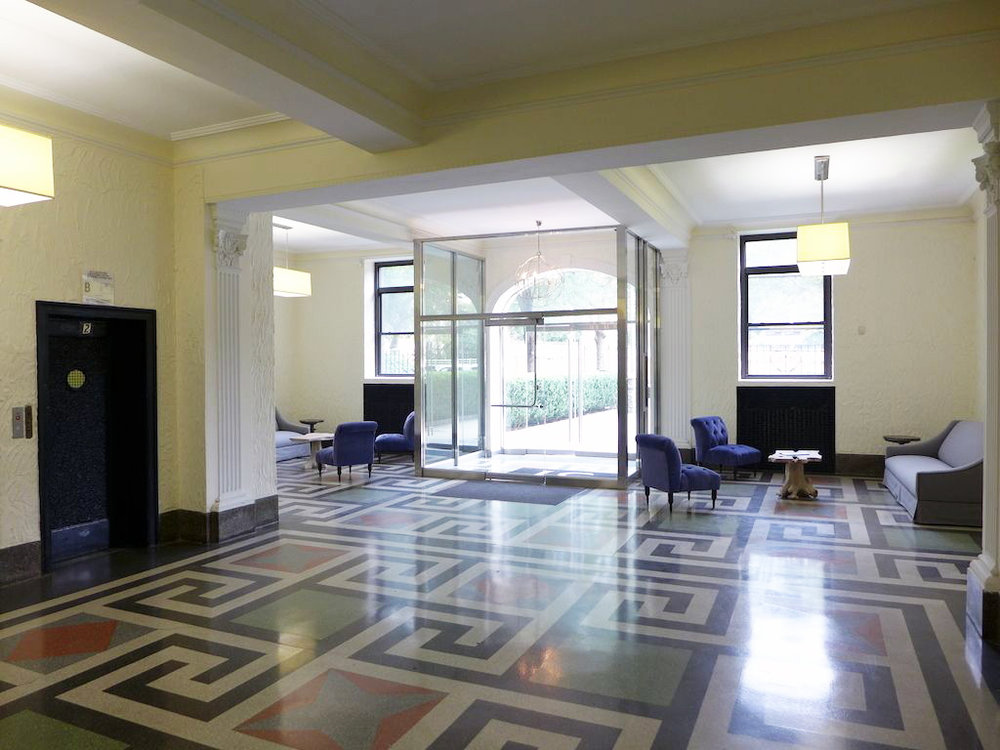 Lobby and seating area with rectangular cuboid overhead lighting and geometric flooring in 31 Ocean Parkway, Brooklyn, New York. MEP designed by 2LS.