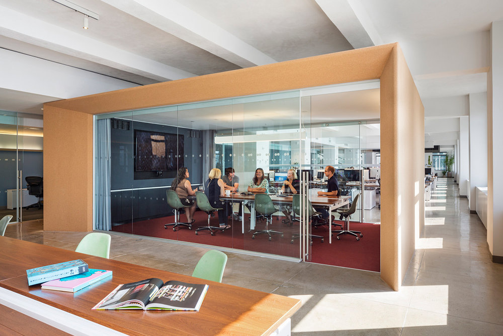 People strategizing and having a meeting in a private conference room located in the Droga5 offices. MEP designed by 2L Engineering.