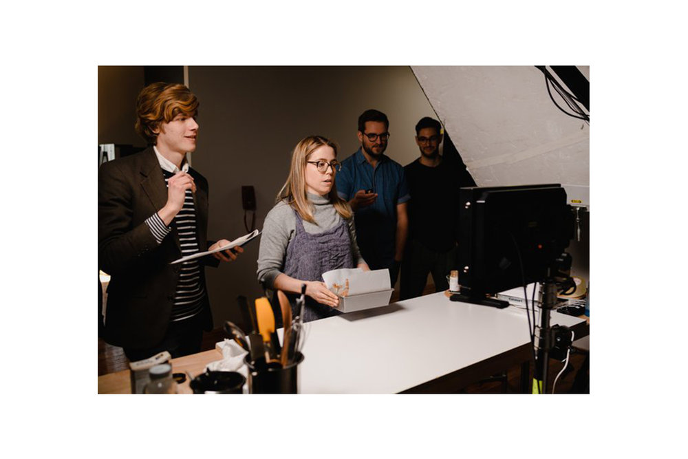 A baker and film crew review footage  at the kitchen studio of Conde Nast, located in Brooklyn, New York. MEP provided by 2LS Consulting Engineering.