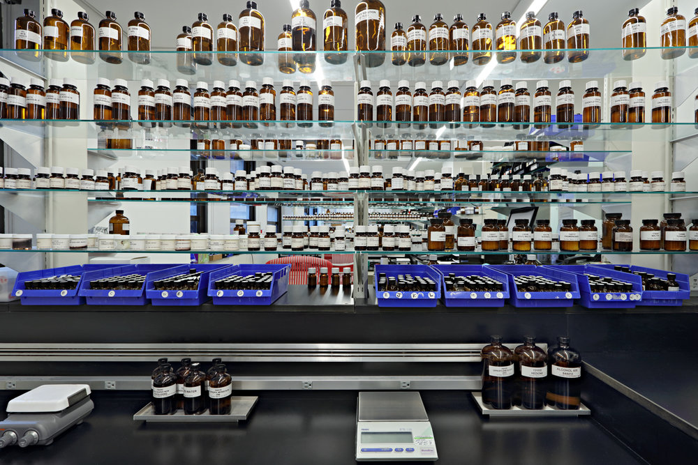 Various fragrances and oils in bottles on multiple shelves at the labs of Symrise in New York. MEP designed by 2L Engineering.