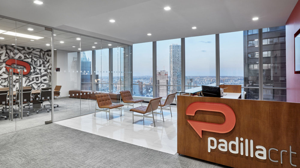 Reception area and waiting area facing a conference room in the offices of communications agency, Padilla CRT. MEP services provided by 2L Engineering.