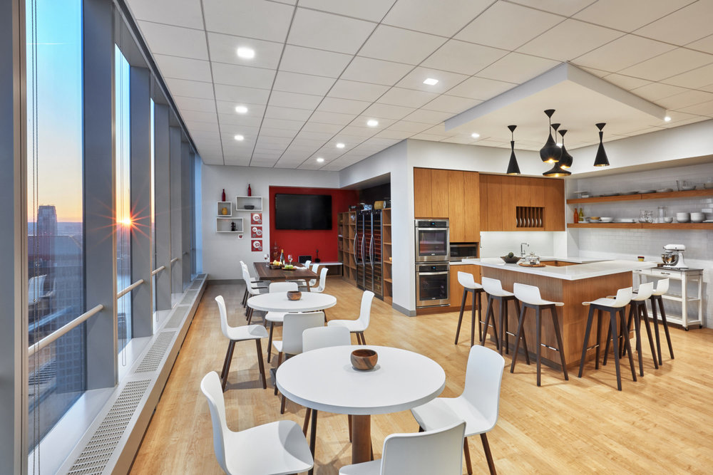 Break room with kitchenette and multiple seating areas for the employees of Padilla CRT in New York. MEP designed by 2LS Consulting Engineering.