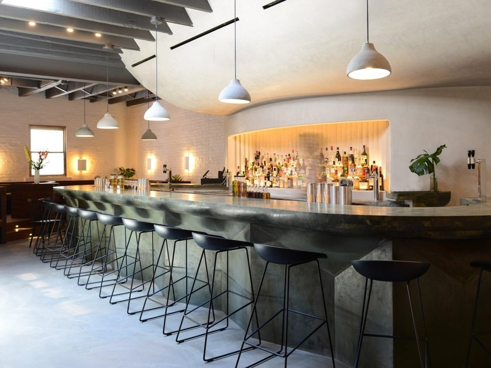 Isaac-Rae hides cave-like cocktail bar behind Williamsburg coffee shop - August 20, 2018 | DezeenA green rock counter curves in front of bulbous plaster walls inside this bar in Williamsburg, Brooklyn, designed by local architecture studio Isaac Rae for a space tucked behind a cafe. …Read More