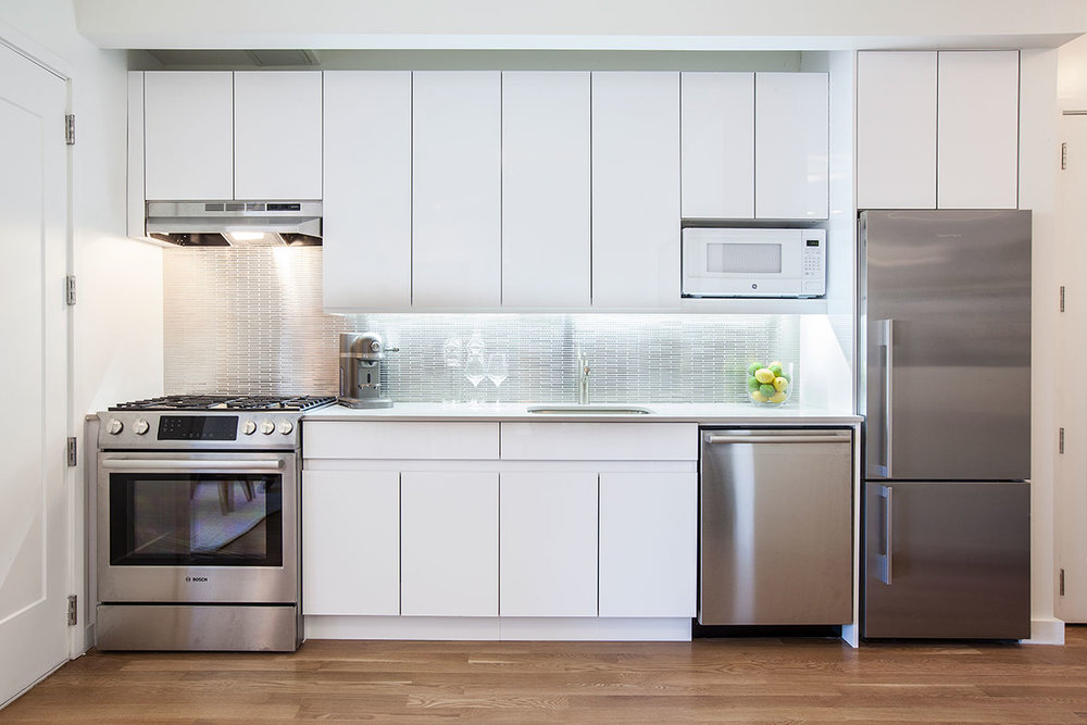 The kitchen of an apartment at The Lefferts House at 195 Hawthorne Street with MEP-FP engineering services provided by 2LS